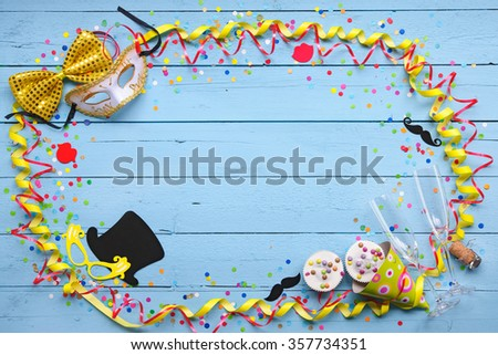 Colorful carnival background with party accessory, streamers, confetti, ribbon, doughnuts and champagne glasses - stock photo