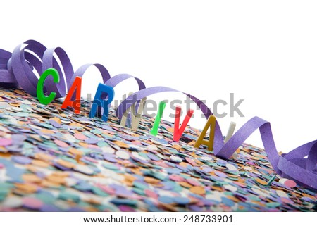 Colorful Carnival text in capital letters with confetti and serpentine on white background  - stock photo