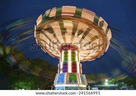 colorful carousel in motion  - stock photo