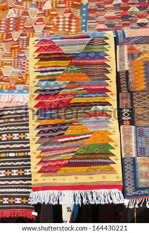 colorful carpets at an Arabian market in Marrakesh, Morocco - stock photo