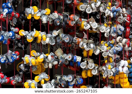 Colorful casters hanging in a Vietnamese street shop - stock photo