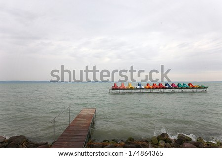 Colorful catamarans in lake - stock photo