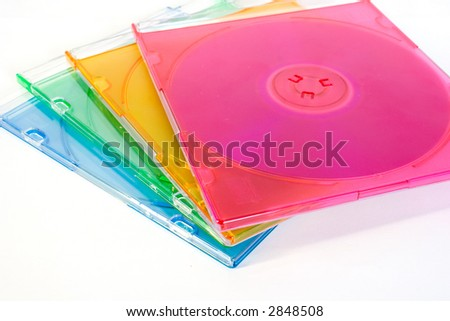 colorful CD boxes isolated on white