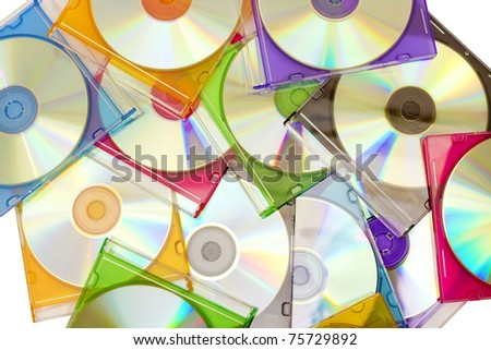 colorful CDs in boxes piled in a heap