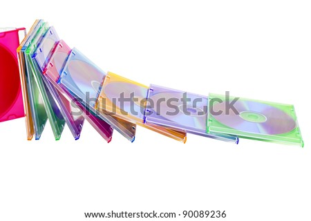 colorful CDs in boxes piled in a heap isolated on a white background