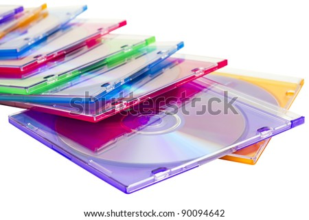 colorful CDs in boxes piled in a heap isolated on a white background - stock photo