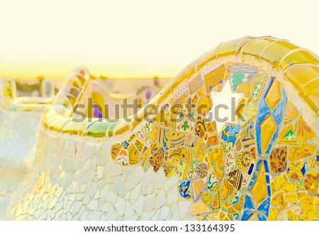 Colorful ceramic bench details at the Parc Guell designed by Antoni Gaudi, Barcelona, Spain. - stock photo