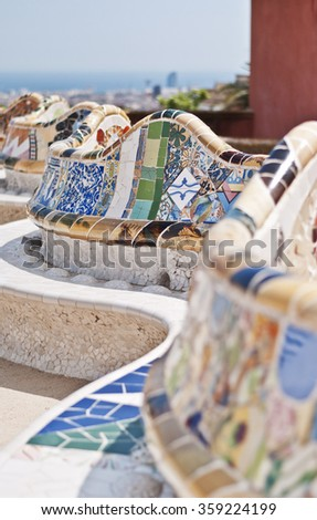 Colorful ceramic bench in Guell Park, Antonio Gaudi, Barcelona, Spain - stock photo
