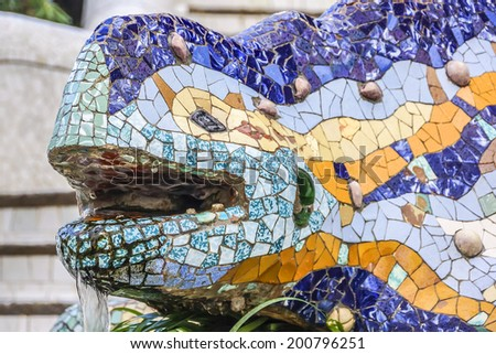 Colorful ceramic Dragon salamandra in Park Guell. Park Guell (1914) is the famous architectural town art designed by Antoni Gaudi. Barcelona, Spain. - stock photo
