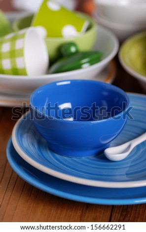 colorful ceramic kitchen utensils on the table - stock photo