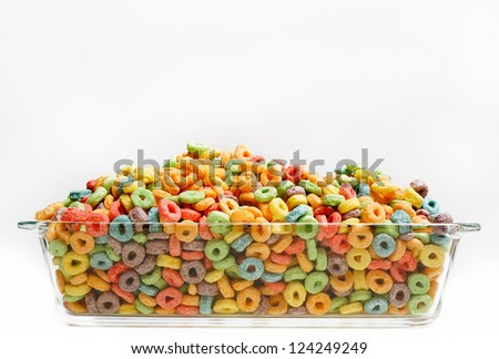 Colorful cereal in bowl on white background - stock photo