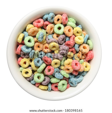 Colorful cereal in white bowl on white background - stock photo