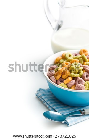 colorful cereal rings with milk on white background - stock photo