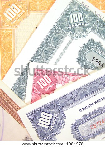 Colorful certificates for common and capital stock shares. - stock photo