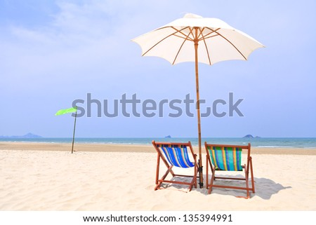 Colorful  chairs on tropical beach - stock photo