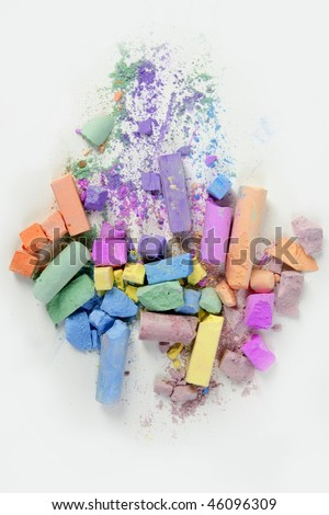 Colorful chalk broken colors mess over white background