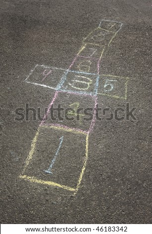 Colorful chalk hopscotch board in the schoolyard - stock photo