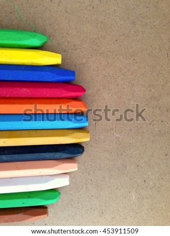 Colorful chalk isolated on wood background
