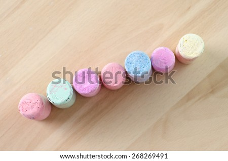 colorful chalk on wooden board - stock photo