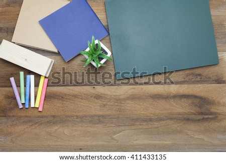 Colorful Chalks,Chalk board,book and eraser on wooden background
