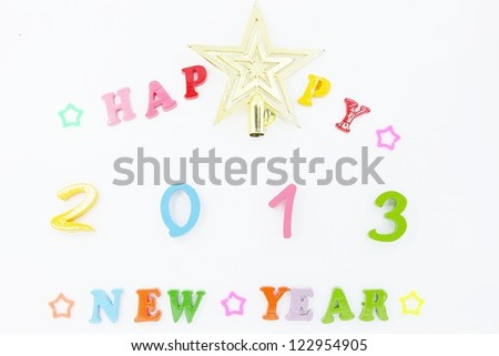 colorful character made from resin. Happy New Year 2013 - stock photo