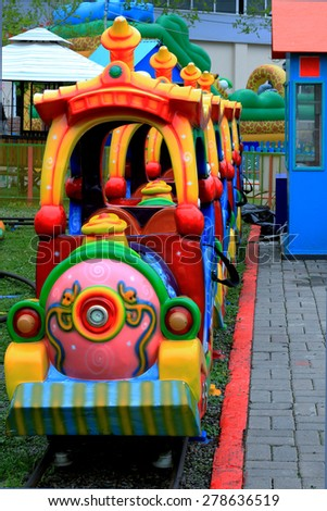 colorful cheerful train at an amusement park