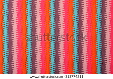 Colorful chevron striped background. Vertical zig zag stripes pattern on fabric.