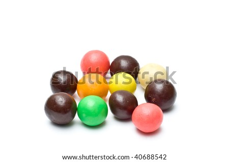 Colorful chewing gums and chocolate balls fanned out isolated on white - stock photo