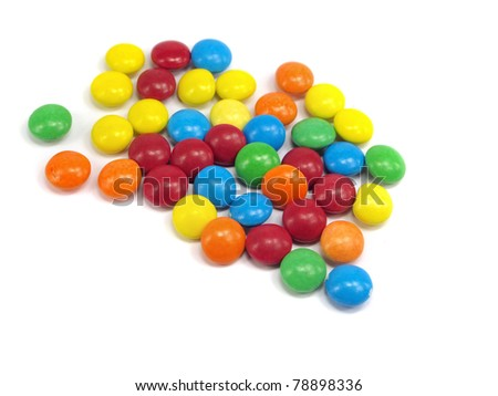 colorful chewy dragees on a white background - stock photo