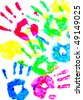 Colorful child hand prints on white background - stock photo