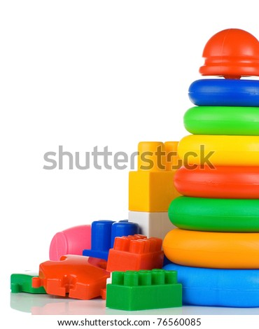 colorful child plastic toys and bricks isolated on white background