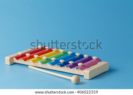 colorful child's glockenspiel with mallets - stock photo