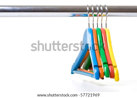 Colorful children clotheshangers isolated on white background. - stock photo