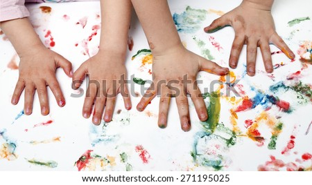 Colorful children hand print on the wallpaper - stock photo