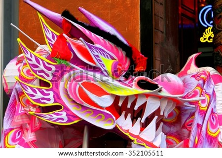 Colorful Chinese dragon used in a parade. - stock photo
