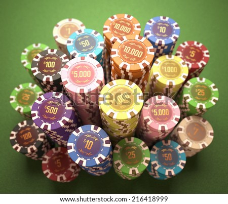 Colorful chips on a green table. Concept of casino and gambling. Clipping path on the chips. - stock photo