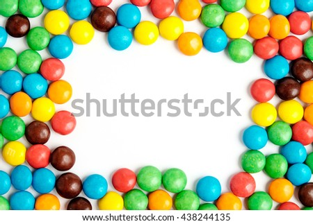 Colorful chocolate candies frame with white space - stock photo