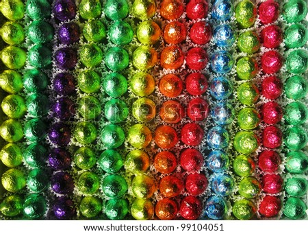 colorful chocolate easter eggs rainbow - stock photo