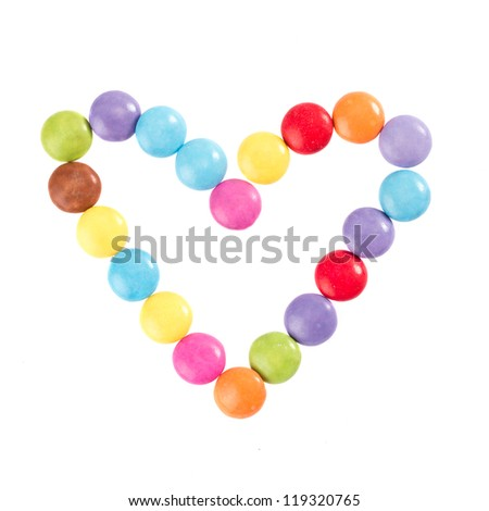 Colorful chocolate in front of white background - stock photo