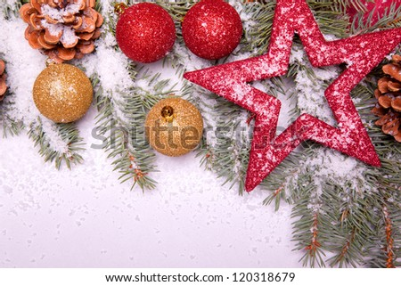 colorful christmas ball ornaments with pine tree on snow