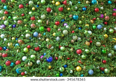 Colorful christmas balls background on tree  - stock photo