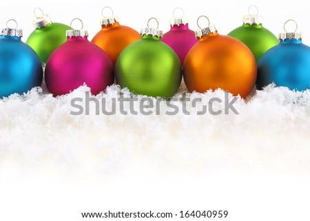 Colorful Christmas balls on the snow - stock photo
