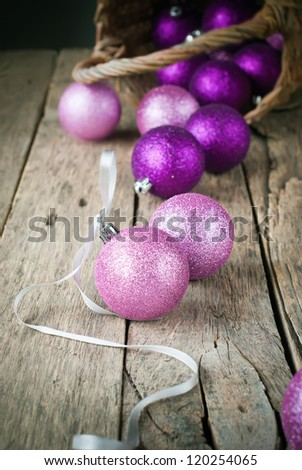Colorful Christmas Balls Scattered on the Wooden Table - stock photo