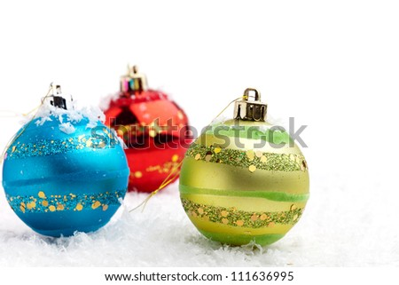 Colorful Christmas baubles on white isolated background - stock photo