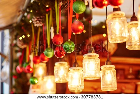 Colorful Christmas decorations and glass lanterns on a Parisian Christmas market - stock photo