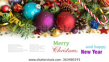 Colorful Christmas decorations - baubles, stars and pine cones isolated on white