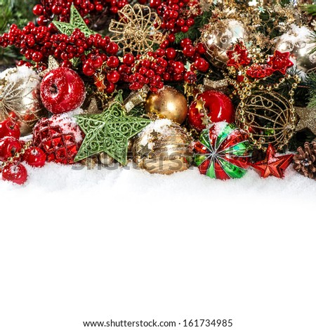 Colorful christmas decorations in red, gold, green. Festive background with place for your text