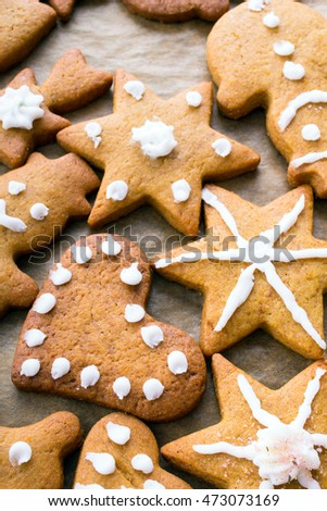 Colorful Christmas gingerbread cookies on  baking paper