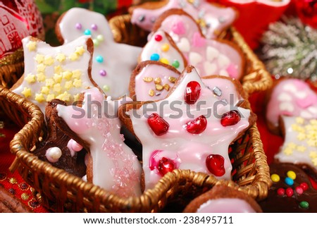 colorful christmas gingerbread cookies with icing and sprinkles made by kids  - stock photo