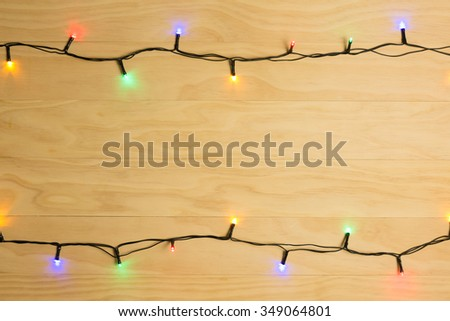colorful Christmas lights on wooden background